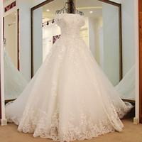 vestido de casamento princesa grande trem venda por atacado-Princesa Vestidos De Casamento Sweep Train Lace Up Barato Apliques De Renda Sobreposição Vestido De Noiva De Noiva De Luxo Com Grande Arco