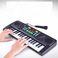 mikrofoninstrumente großhandel-Kinder Elektronische Mini Piano Spielzeug 37 Tasten Mit Mikrofon Kunststoff ABS Batteriebetriebene Kinder Tragbare Musikinstrumente 22 5bj KK