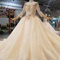 74d22003f9 Golden Lace Wedding Gowns O-Neck Three Quarter Sleeve Ball Gown Flowers  Beaded Wedding Dress Spring 2019 Latest Design Dress