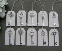 ingrosso grande chiave antica-Misto 100 pezzi argento antico scheletro Keys100 pezzi bianchi tag nozze scheletro chiavi fascino grande dimensioni 53-68mm