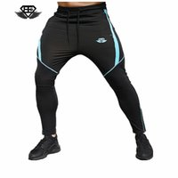 Wholesale mens patterned cotton pants resale online - BE Embroidered Mens Brand Designer Jogger Pants Panelled Muscle Brother Sweatpants Male Casual Thin Pencil Pants Gym Athletic Trouser
