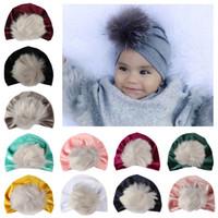 Wholesale baby hair beanie online - New newborn velvet hair ball hat European American children s cap pom pom hat Pleuche beanies Baby pullover hats colors AAA1357
