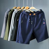 ingrosso nuovi pantaloni alla moda-Pantaloncini da uomo di design 2019 Pantaloncini casual estivi da uomo in cotone Homme Pantaloncini da spiaggia casual eleganti Pantaloni corti da uomo di moda nuovi DH066