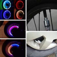 luz de la motocicleta para los neumáticos al por mayor-Auto-inducción Flash Wheel Tyre Valve Cap Lámparas LED para automóviles Motocicleta Bicicleta Motor eléctrico Neumáticos Candelabros Rainbow Blue Red