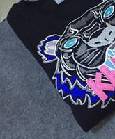 sudaderas sudaderas chaqueta suéter al por mayor-Envío gratis Hot Men Women Embroidere tiger logo suéter chándal jumper chaqueta de las mujeres Hoodies sudaderas negro / blanco tamaño S-2XL