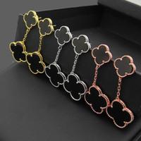 siyah asılı küpeler toptan satış-Paslanmaz çelik siyah ve beyaz kabuk asılı kabuk dört-yaprak earrings18K altın saplama küpe kadın moda takı
