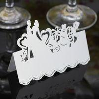 mesas de corte al por mayor-Tarjetas de lugar de corte por láser Tarjeta de nombre de papel hueco con los amantes para la fiesta Tarjetas de asiento de boda Decoración de mesa de boda PC2005