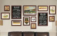 malen foto kulisse großhandel-Luxus Wohnzimmer Büro Sofa Hintergrund Dekorative Malerei Kreative Atmosphäre Schwarz Bilderrahmen Gemälde Hängende Ornamente