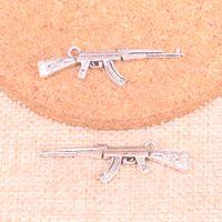 ingrosso macchina di fabbricazione della collana-44 pz argento antico mitragliatrice fucile d'assalto ak-47 pendente di fascini misura i braccialetti collana diy monili del metallo che fanno 44 * 15mm