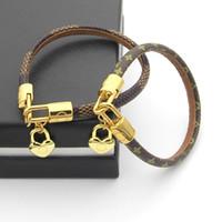 ingrosso sacchetto di plaid genuino-Bracciale in vera pelle di titanio con cuore in oro e borsa design per donna