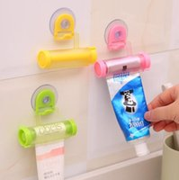 Wholesale plastic partners - Creative Rolling Squeezer Toothpaste Dispenser Tube Partner Sucker Hanging Holder Bathroom Rolling Toothpaste Tools CCA9004 200pcs