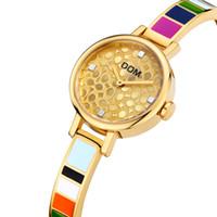 kore altın saati toptan satış-Kadınlar altın lüks İzle tasarımcı marka DOM saatler Kore renkli Basit kuvars bayan İzle yedi renk su geçirmez Saatler