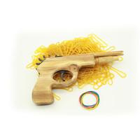 holzpistole kinder großhandel-Neue Kreative Unbegrenzte kugel Klassische Gummiband Launcher Holz Handpistole Pistole Schießen Spielzeug Geschenke Outdoor Fun Sport Für Kinder