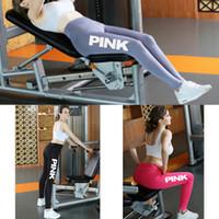 ingrosso pantaloni di yoga rosa di colore delle signore-Pantaloni sportivi di colore rosa delle donne dei pantaloni di yoga delle calzamaglia di sport delle donne sexy di colore solido correnti dei pantaloni di forma fisica stampati liberi di trasporto 51