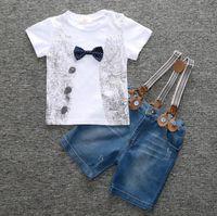 Wholesale 12 month boy jeans - New Europe Fashion Boys Clothes Set Kids Short Sleeve Tops T-shirt + Suspender Jeans Shorts Children Boy 2pcs Outfits W153