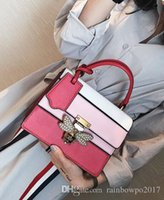 Wholesale butterfly totes for sale - Group buy outlet brand fashion elegant woman handbag bag butterfly diamond clamshell handbag color stripe stitching leather handbag fan in Europe