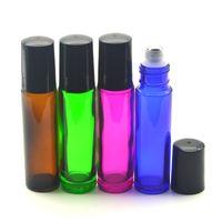 botellas de aceite de perfume de vidrio verde al por mayor-Hot 10ml Glass Roller Bottle Green Para el aceite esencial Roll-on Perfume Recargable Rodillo de muestra Contenedor de vidrio con tapas negras Envío gratis