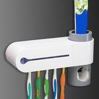 ultraviyole sterilizatör toptan satış-Çevre dostu 2 In 1 Bakteri Ve Uv Işık Ultraviyole Diş Fırçası Otomatik Diş Macunu Dispenser Sterilizatör Diş Fırçası Tutucu Temizleyici Ul Fiş