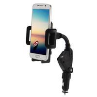 soporte para coche iphone usb al por mayor-Soporte giratorio del teléfono del coche Soporte Dual USB Charger Cradle para Iphone Samsung Xiaomi Huawei LG Motor HTC Universal Smartphones
