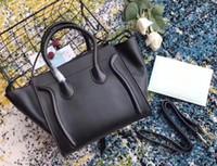 Wholesale face strap for sale - Group buy Luxury Women Smiling Face Bag Trapeze Tote Handbag High Quality Cowhide Genuine Leather Designer Shoulder Strap Bat Bag Clutch Handbag