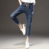 pantalones de spandex caliente más tamaño al por mayor-Pantalones de moda para mujer Moda suelta Casual Vintage apenado Regular Spandex Pantalones de mezclilla blanqueados Mujer Jeans Tallas grandes Venta caliente