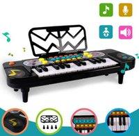 teclados de plastico piano al por mayor-Nueva versión 25 teclas mini teclado electrónico musical niños piano portátil de plástico para niños juguetes educativos de aprendizaje electrónico