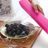 marca filme venda por atacado-Criativo de Alimentos De Plástico Wrap Dispenser Preservativo Cortador De Filme Fácil de Cortar Sem Deixar Marcas Colorido Ferramenta de Cozinha Nova 5yy Z