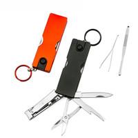 ücretsiz nakliye swiss bıçakları toptan satış-Mini Moda Anahtarlık İsviçre Bıçak LED Işıkları Tırnak Makası Earpick Makas Cımbız Cep İşlevli El Aletleri Ücretsiz Nakliye