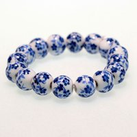 ingrosso braccialetto cinese di porcellana-Braccialetto in perline di porcellana bianca e blu vintage in stile cinese Accessori da donna