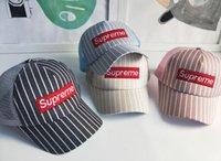 Wholesale new helmet summer - Summer new children's tennis helmet, striped sun hat, summer sun hat, 4-8 year old children's cap.