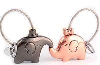 pendentif cochon mignon achat en gros de-Petit cadeau cochons kiss éléphant mignon baiser porte-clés amants baleine une paire d'hommes et de femmes mignonne bague pendentif.