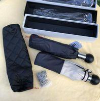 blumenartikel großhandel-Wholesale klassisches Muster Kamelien-Blumenlogo Luxuxregenschirm 3 falten Luxuxregenschirm (Geschenkbox + Kette Beutel) Art und Weiseansammlungseinzelteil