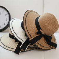 chapéu de abas largas de palha preta venda por atacado-Chapéu de sol Grande Arco Preto Chapéus de Verão para o Pai-filho Dobrável Palha Praia Panamá Chapéu Visor De Largura Brim Femme feminino