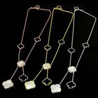 jóias pérolas brancas venda por atacado-Nova trevo de quatro folhas colar de jóias para as mulheres longo colar de pingente preto branco mãe shell pérola pingente Dropshipping