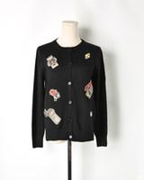 suéter negro botones de oro al por mayor-Envío gratis 2018 negro más ligero jacquard de las mujeres Cardigans marca mismo estilo Gold Line botones mujeres suéteres DH081422