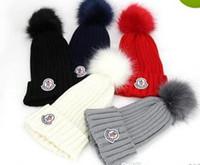 chapéus grandes pom venda por atacado-Hot Unisex Marca de inverno classcal mulheres chapéu de malha homens moda gorros de pele grande pom-pom gorro menino casual meninas de esqui meninas bonés de caveira Bonnet