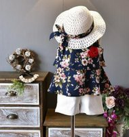 pantalón blanco sin mangas al por mayor-Nueva camiseta de flores para niña de verano 2018 + pantalón corto blanco + gorro traje 3 piezas