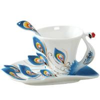 tazas de esmalte de ceramica al por mayor-El nuevo diseño del pavo real taza de café de cerámica creativa de café Bone China 3d esmalte del color taza de porcelana con plato y cuchara de café Juegos de té