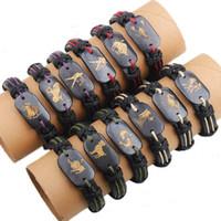 Wholesale china handmade leather charm bracelets - wholesale 12pcs per lot trendy handmade vintage the signs of the zodiac cuff leather bracelet