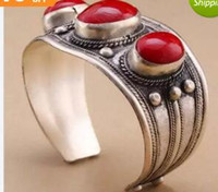 rotes armband tibet groihandel-Unisex Vintage Oval rote Koralle Stein Perlen Manschette Armband Tibet