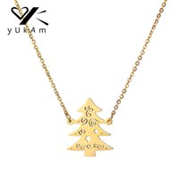 ожерелья семейного древа оптовых-YUKAM Creative Xmas Jewelry Gold Hollow Stainless Steel Family Christmas Tree Pendants Necklaces for Women Party New Year Gifts