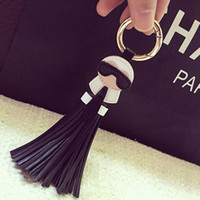 Wholesale zinc alloy chains for sale - Group buy Cute Big Brand Karl Genuine Tassels Monster Bag Bugs Car Ornaments Leather Tassels Bag Charm Key Chain K008 black