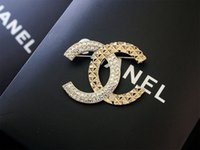 Wholesale brass rhinestone brooch online - 2019 design Celebrity Letter Pearl diamond Opal Brooch decorations Fashion Metal Letter Butterfly knot brooch Jewelry With Box