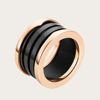 casamento de anel de pedras preciosas de 18k venda por atacado-Mens Luxo 18 K Sólido Amarelo Banhado A Ouro Preto Branco Cerâmica Gemstone Anéis De Noivado de Ouro Amantes Do Casamento Casal Anel para as Mulheres