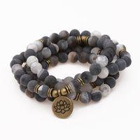 ingrosso nero onice mala-Natural Smile Black White Onyx Bracciale 108 Mala Beads Braccialetto o Collana Lotus Pendant Chakra Yoga Preghiera all'ingrosso