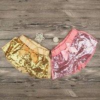 pantalon corto para niña rosa al por mayor-Oddlers chicas lentejuelas pantalones cortos 2 colores Gold Pink ribbon bowknot shorts niños lindos lentejuelas pantalones para 1-4T B11