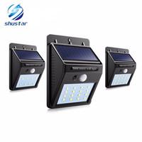 sensor de movimiento de iluminación led al por mayor-Potencia solar LED Luz solar Lámpara de pared LED al aire libre Lámpara solar con sensor de movimiento PIR Noche Bulbo de calle Patio de jardín Lámpara