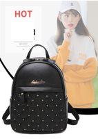 einfache mädchen rucksäcke schwarz großhandel-Neue Ankunfts-Mädchen-Rucksack-Art PU-Leder Reißverschluss Plain Rivet Design Schwarz Weiß Tiefblau Burgund Farbe niedlichen Stil für Mädchen