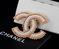 Wholesale metal letters zinc resale online - Factory Sell Quality Celebrity Design Letter Pearl Diamond Brooch Fashion Letter Metal Buckle Brooch With Box