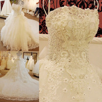 Wholesale sexy beaded strapless wedding dresses online - Elegant Strapless Wedding Dresses Sleeveless Tiered Skirts Sexy Back Luxurious Bridal Dresses Beaded Crystals With Ruffles Wedding Gowns